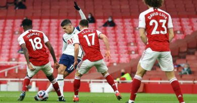 Tottenham's Erik Lamela scored a stunning 'rabona' goal but was later sent off as Arsenal came from behind to win a thrilling north London derby.