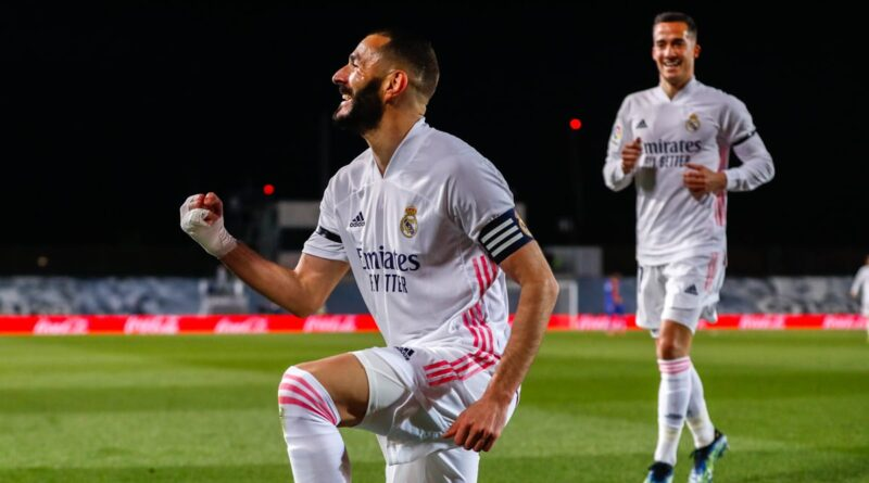 Real Madrid moved top of La Liga with victory over Barcelona in an El Clasico played in torrential rain at the Alfredo Di Stefano Stadium.