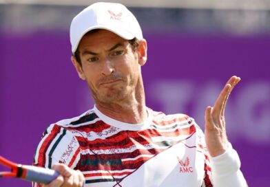 Andy Murray made an emotional and winning return in his first singles match on grass for three years as he reached the second round at Queen's.