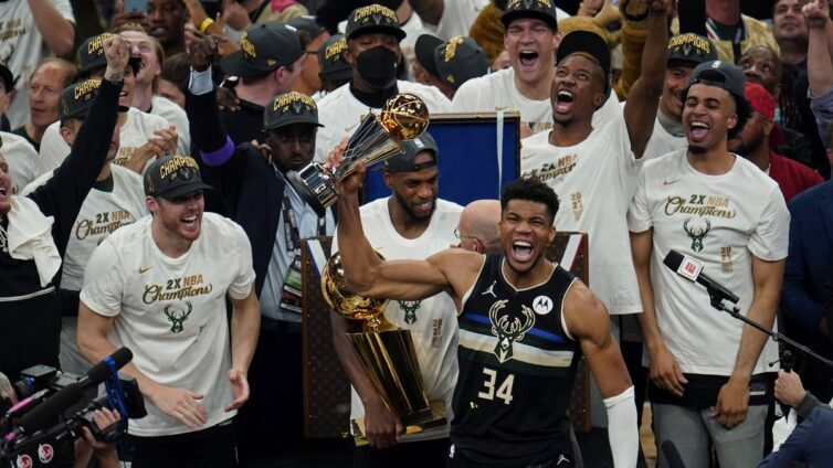 Giannis Antetokounmpo scored 50 points as the Milwaukee Bucks claimed their first NBA title for 50 years with a 105-98 victory over the Phoenix Suns.
