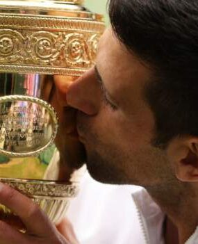Novak Djokovic won his sixth Wimbledon title to equal Roger Federer and Rafael Nadal's record of 20 men's Grand Slam victories after fighting back to beat Italy's Matteo Berrettini.